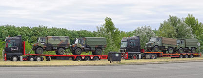Kfor convoy. ROSZKE, HUNGARY - JULY 09, 2015: Kfor convoy stopped at border crossing in Roszke, Hungary. Transport of military truck at checkpoint between Serbia Royalty Free Stock Image