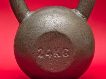 24 kg kettlebell. On magenta pink background royalty free stock photos