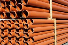 KG sewer pipes. Orange/ brown KG sewer pipes stock photo