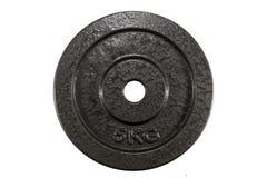 5 kg stålplatta för att att lyfta för vikt ska förminska fett och som ska förstärkas Arkivfoto