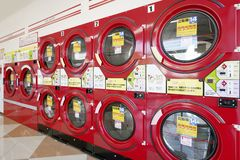 Industrial laundry machine. KGAWA, JAPAN - OCTOBER 29, 2018: Row of industrial washing machines in a public laundromat royalty free stock photos
