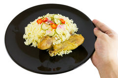 Kgawhmk chicken. On a black plate Royalty Free Stock Image