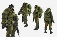 Kgb spestnaz toy miniature and figure motion isolate white backgrounds Stock Photo