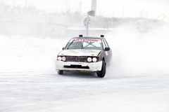 KHABAROVSK, RUSSIA - March 7, 2015: Old car at winter ice track Stock Image
