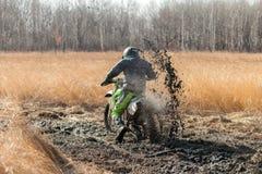 KHABAROVSK, RUSSIA - OCTOBER 23, 2016: Enduro bike rider on a fi Stock Photos