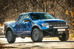 Khabarovsk, Russia - october 20, 2016: Ford F150 Raptor SUV is on the road driving on dirt Stock Photo