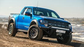 Khabarovsk, Russia - october 20, 2016: Ford F150 Raptor SUV is on the road driving on dirt Royalty Free Stock Image
