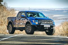 Khabarovsk, Russia - october 20, 2016: Ford F150 Raptor SUV is on the road driving on dirt Royalty Free Stock Photography