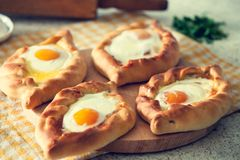Khachapuri in Adjara with the egg. The Georgian cuisine stock image