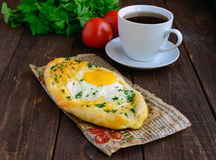 Khachapuri in Adjara (flat cakes with different fillings in the form of a boat) - the national dish of Georgian cuisine Stock Photo