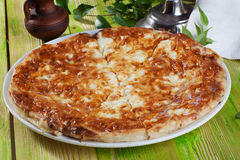Khachapuri with cheese round on the board still life wooden table beautifully tasty appetizing Stock Photos