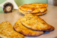 Khachapuri ghvezeli in a half moon form for christmas day, Geo Royalty Free Stock Photo