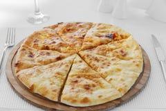 Khachapuri pie with cheese round Royalty Free Stock Image