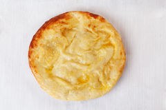 Khachapuri round top on a white background golden mouthwatering delicious. Isolation Stock Photo