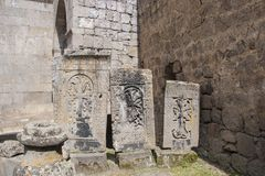 Khachkar is an ancient stone, a cross stone. They are located on the territory of Tatev Monastery. Armenia. Listed in the UNESCO list Stock Photos