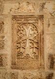 The Khachkar - armenian cross-stone, Cathedral of Saint James in Jerusalem, Israel. The Khachkar, armenian cross-stone on the walls in the courtyard of the stock photo