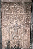 Khachkar or cross-stone. Cross-stones or khachkars in the 9th century Armenian monastery of Sevanavank. Khachkars are carved memorial stele, covered with royalty free stock photo