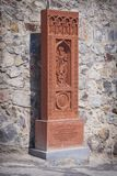 Khachkar St. Gregory in the territory of the temple ensemble Khor Virap in Armenia. A copy made from an ancient khachkar - a stone-cross. Made of stone tuff Stock Photography