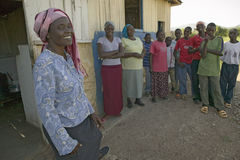 Khadija Rama, standing with a group of people, is the founder of Pepo La Tumaini Jangwani, HIV/AIDS Community Rehabilitation Progr Stock Photos