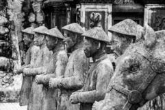 Row of statues at the Khai Dinh Emperor`s Mausoleum in Hue, Vietnam, with other statues in the background stock photo