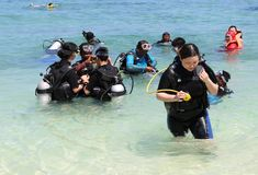Asian Tourist Group learning how to snorkel Royalty Free Stock Photo