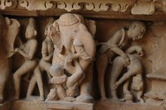 Erotic sculpture at Khajuraho Temple, India royalty free stock photo