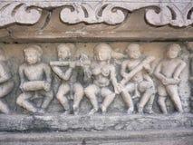 Khajuraho, Mahadeva Tempel, erotische gravure Stock Afbeelding