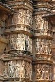 Khajuraho tempel och deras erotiska skulpturer, Indien Royaltyfria Bilder