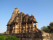 Khajuraho Temple Group of Monuments in India with erotic sculptures on the wall stock photo