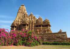 Khajuraho temple in India on a sunny day with blue sky Royalty Free Stock Photography