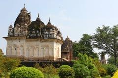 Khajuraho temples and their erotic sculptures, India. Khajuraho, India has manyl Hindu temples, famous for their erotic sculptures stock photo