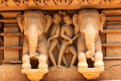 Khajuraho temples and their erotic sculptures, India. Khajuraho, India has manyl Hindu temples, famous for their erotic sculptures stock photography