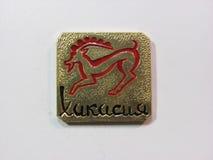 Khakasia共和国标志证章俄罗斯滑稽的petroglif 库存照片