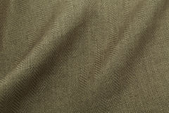 Khaki background luxury cloth or wavy folds of grunge silk texture satin velvet. Abstract background luxury cloth or liquid wave or wavy folds of grunge silk Stock Image