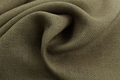 Khaki background luxury cloth or wavy folds of grunge silk texture satin velvet. Abstract background luxury cloth or liquid wave or wavy folds of grunge silk Stock Photos