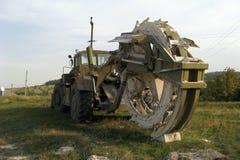 Khaki Color Massive Trench Machine. Massive trench machine, khaki color with black tires Stock Photos
