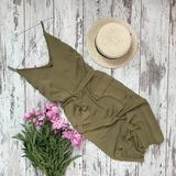 A khaki dress on a wooden background royalty free stock images