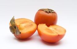 Khaki fruit. Orange khaki fruit against white background Royalty Free Stock Images