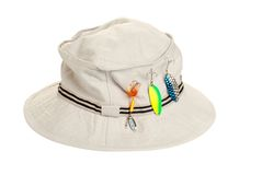 Khaki hat with fishing tackle Stock Image