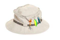 Khaki hat with fishing tackle. Isolated khaki hat with fishing tackle on white background Stock Image