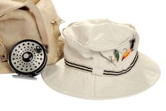 Khaki hat with fly fishing equipment. Isolated khaki hat with fly fishing equipment on white background Royalty Free Stock Image