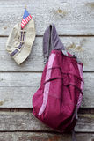 Khaki Hat, US flag and Magenta Backpack Stock Photography