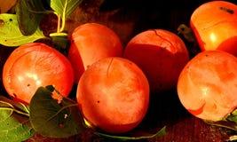 Khaki,fruit,food,organic. Khaki with leaves on old table Royalty Free Stock Photography