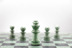 The khaki squad attack. A squad of 5 chess pieces leaded by the king Royalty Free Stock Image