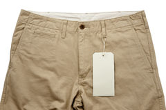 Khaki trousers with tagging. Isolated stock photo
