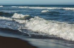 Khalaktyrsky beach with black sand. Pacific Ocean washes Kamchatka Peninsula. Royalty Free Stock Photo