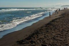 Khalaktyrsky beach with black sand. Pacific Ocean washes Kamchatka Peninsula. Royalty Free Stock Image