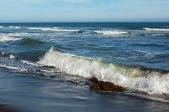 Khalaktyrsky beach with black sand. Pacific Ocean washes Kamchatka Peninsula. Stock Photo