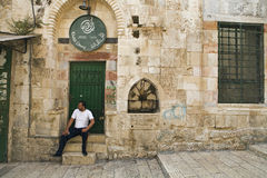 Khalidi Library. A man sits on the steps of the Khalidi Library in the old city of Jerusalem Royalty Free Stock Photo