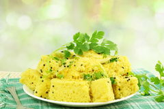 Khaman dhokla traditional gujrati indian snack food dish in de focused circle background Stock Photography